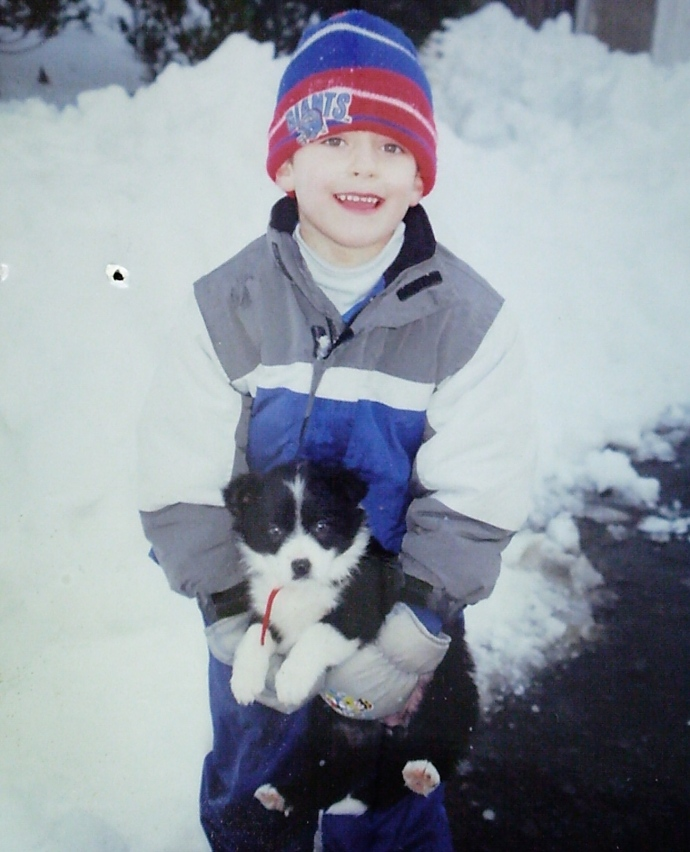 puppy and boy in snow